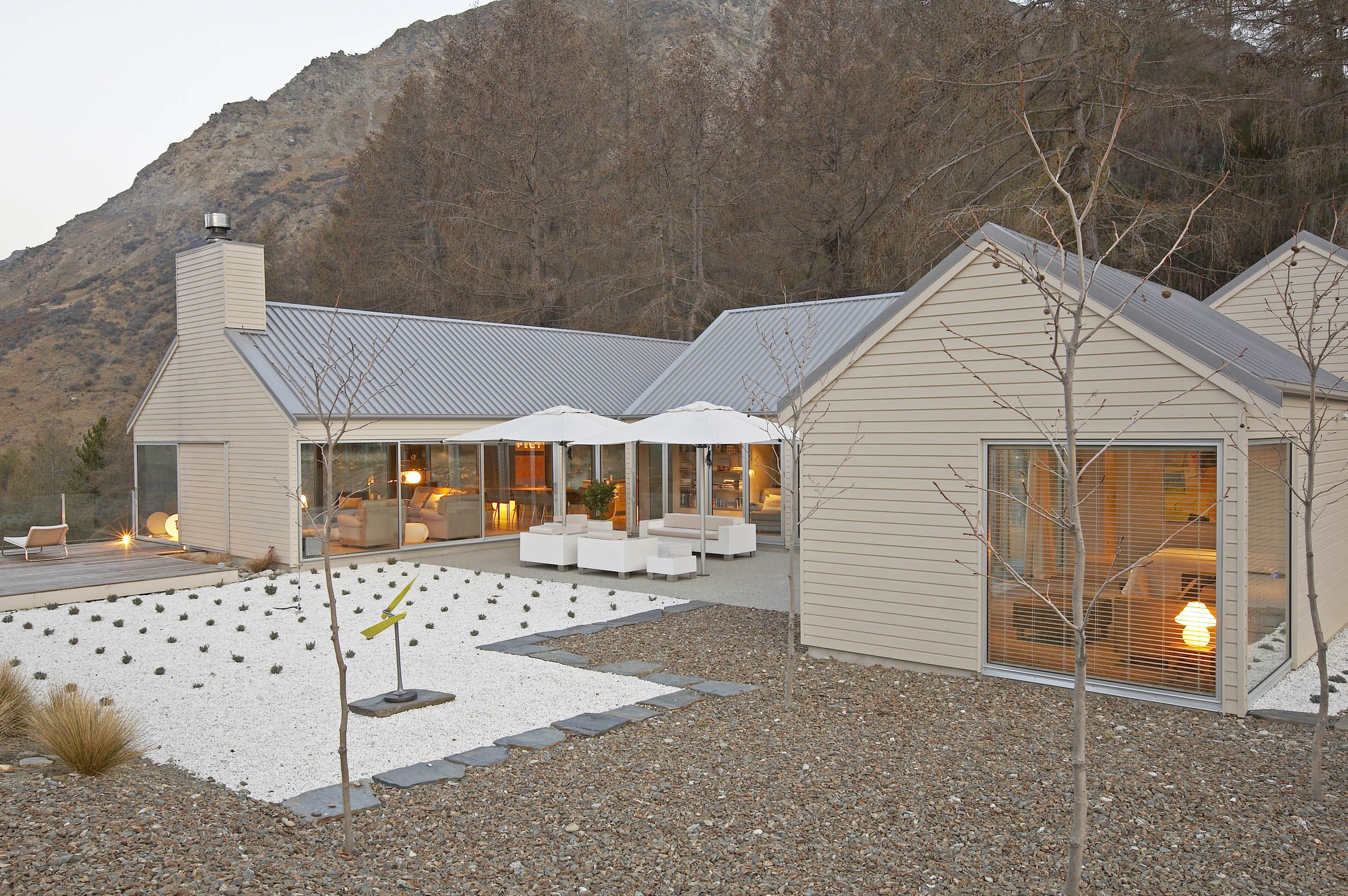 Queenstown architect designed courtyard house white pebble landscaping