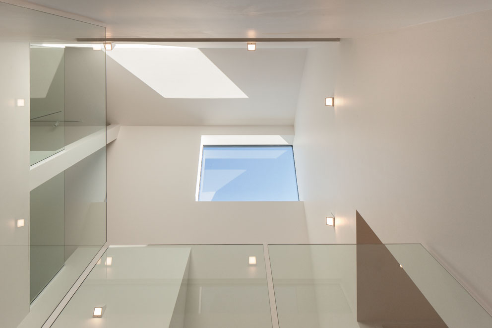 Triple height space glass balustrades skylight