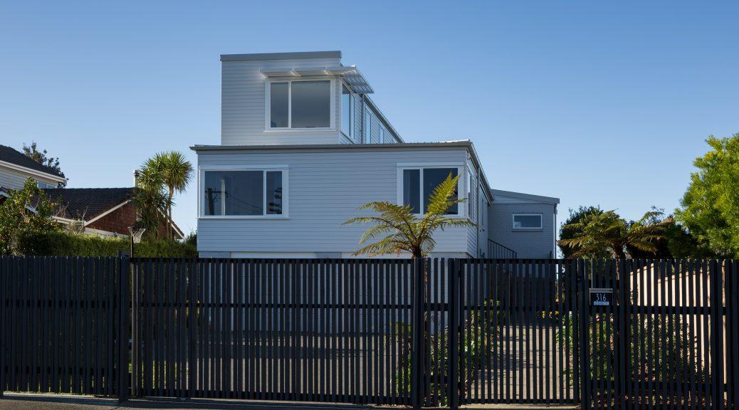 Glendowie modern renovation grey weatherboards slat fence