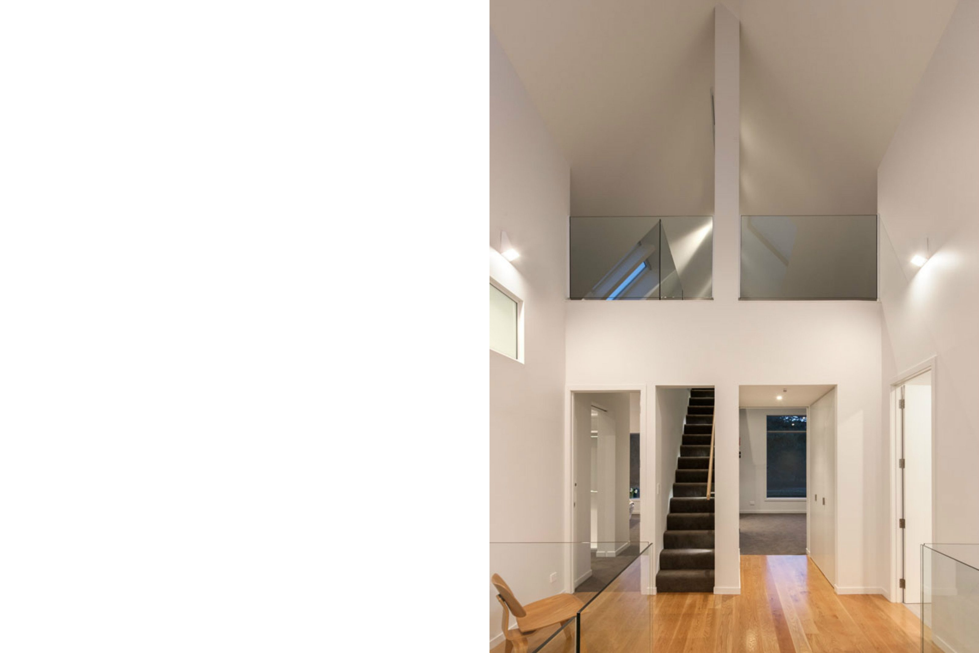Double height space timber floors glass balustrade mezzanine