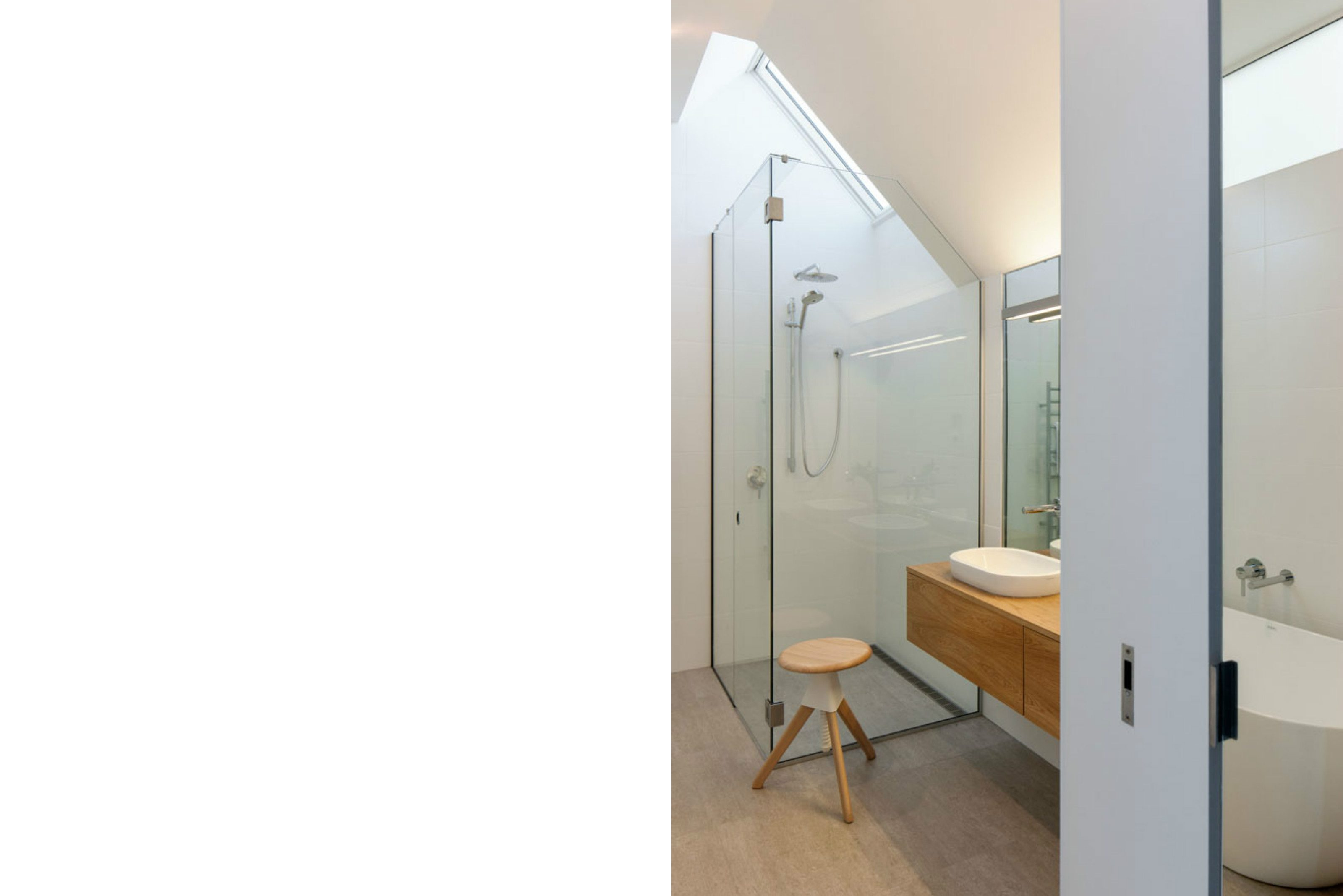 Modern ensuite timber vanity glass shower skylight