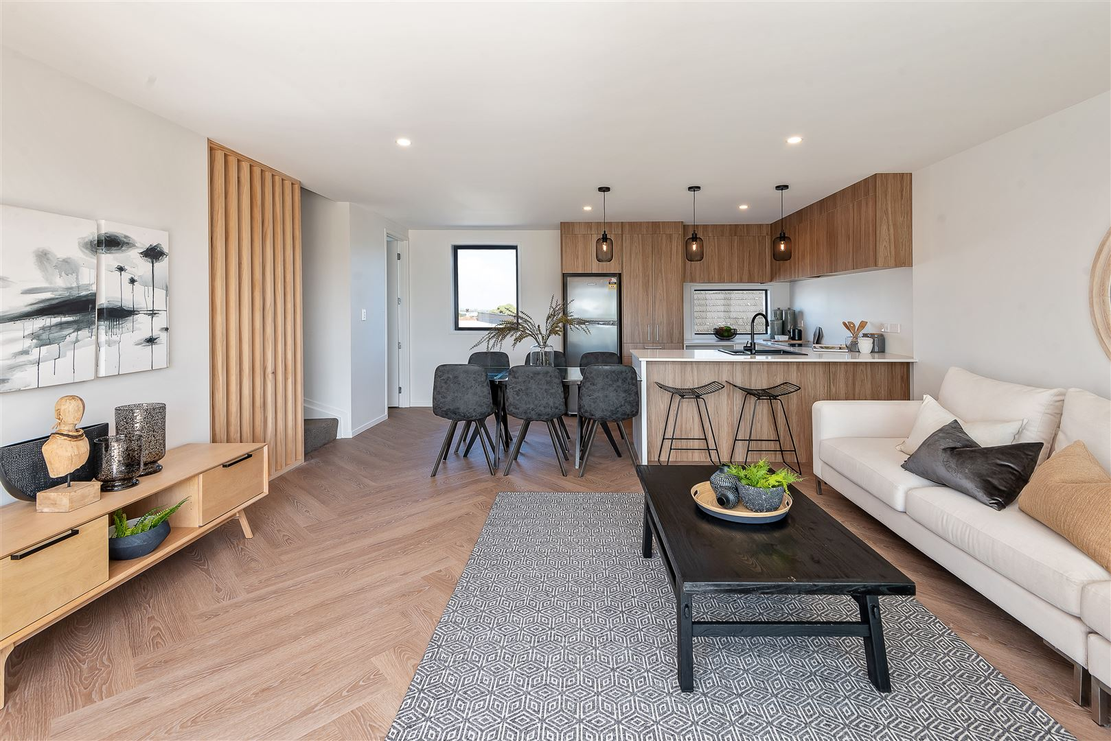 Parquet floors and timber accents are warm and inviting.